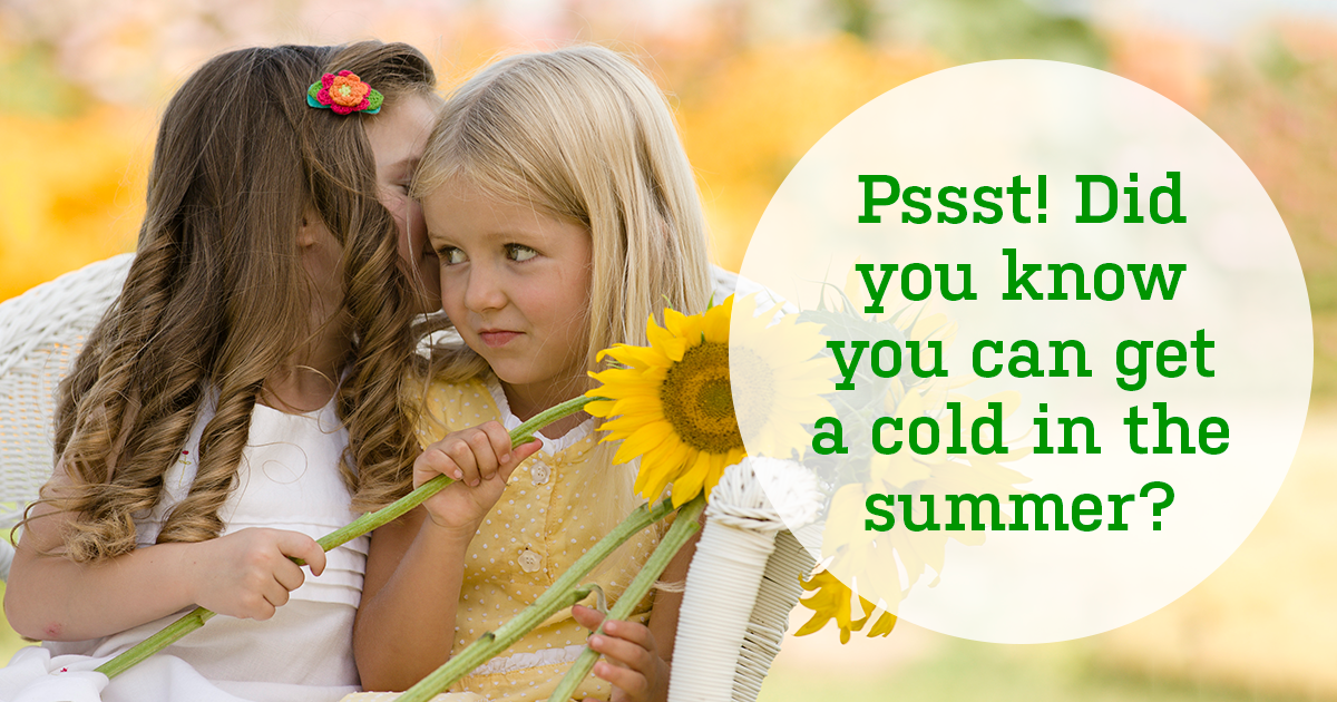 Two little girls sitting in a white wicker chair. One is whispering to the other. Text reads: Pssst! Did you know you can get a cold in the summer?